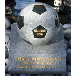 Granite football on base