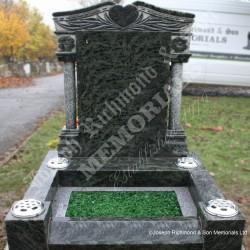 Pillar memorial in tropical green